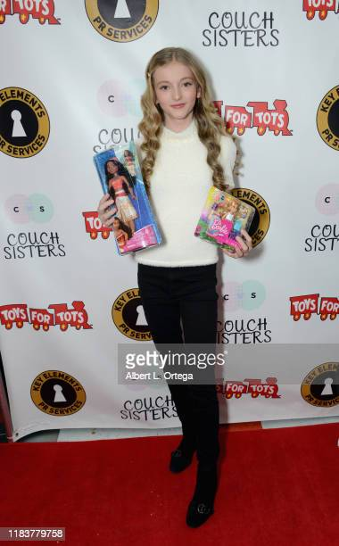Emily Dobson attends The Couch Sisters 1st Annual Toys For Tots Toy Drive held onNovember 20 2019 in Glendale California