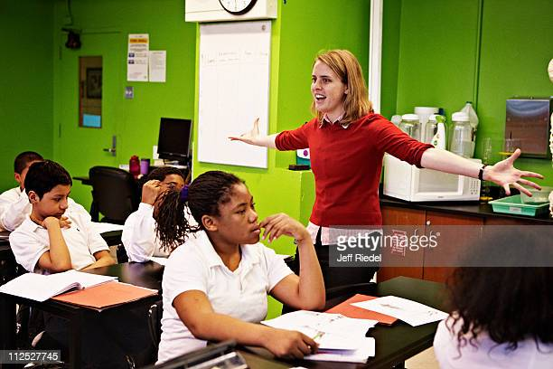 Emily Dodd a teacher at MS 223 is photographed with students for New York Times Magazine on March 29 2011 in the Bronx New York PUBLISHED IMAGE