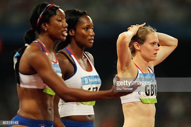 Emily Freeman Montell Douglas and Emma Ania of Great Britain look on after the Women's 4 x 100m Relay Final at the National Stadium on Day 14 of the...