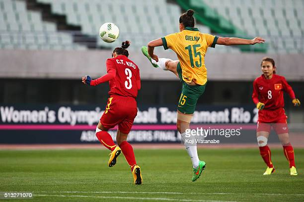 Emily Gielnik of Australia and Chuong Thi Kieu of Vietnam compete for the ball during the AFC Women's Olympic Final Qualification Round match between...