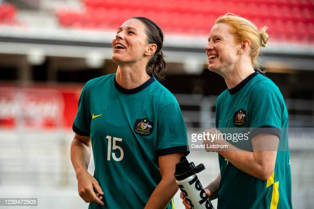 Emily Gielnik of Australia and Clare Polkinghorne of Australia cheer the fans during the Women's International Friendly match between Sweden and...