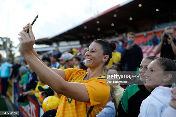 Emily Gielnik of Australia poses with fans after the women's international match between the Australian Matildas and Brazil at Pepper Stadium on...