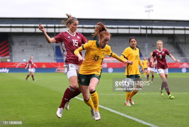 Emily Gielnik of Germany and Beattie Goad of Australia battle for the ball during the Women's International Friendly match between Germany and...