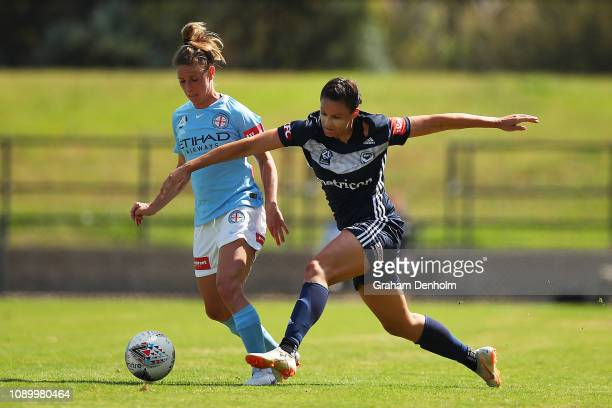 Emily Gielnik of the Victory competes with Elise KellondKnight of Melbourne City during the round 10 WLeague match between the Melbourne Victory and...
