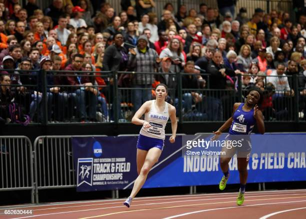 Emily Gustavson of Wheaton Mass and Aurora University's Deterrica Simpkins battle it out on the curve during the 200 meter dash at the Division III...