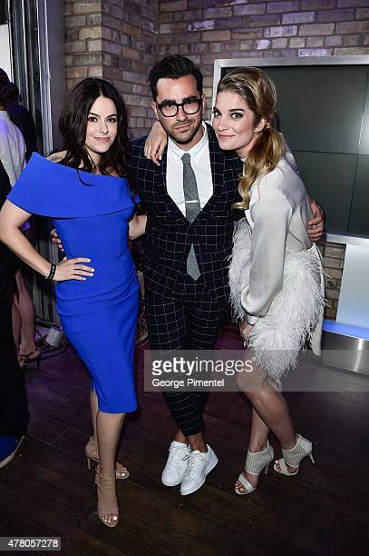 Emily Hampshire Dan Levy and Annie Murphy appear backstage at the 2015 MuchMusic Video Awards at MuchMusic HQ on June 21 2015 in Toronto Canada