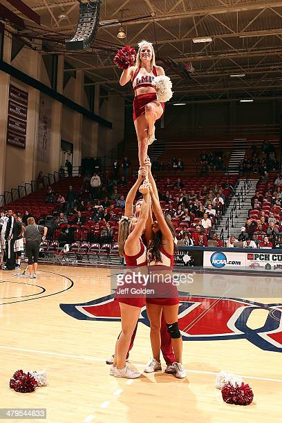 Emily Hand of the Loyola Marymount Lions Cheer Team performs during the first half of the game against the Pepperdine Waves at Gersten Pavilion on...