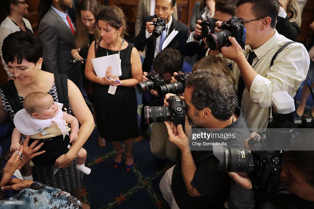 Emily Holubowich and her 6-month-old daughter Jackie are the focus of photographers following a news conference about funding programs to combat the spread of the Zika virus at the U.S. Capitol September 7, 2016 in Washington, DC. Congress returned yesterday from a seven-week break during which time the Florida Department of Health confirmed the first local cases of Zika on July 29.
