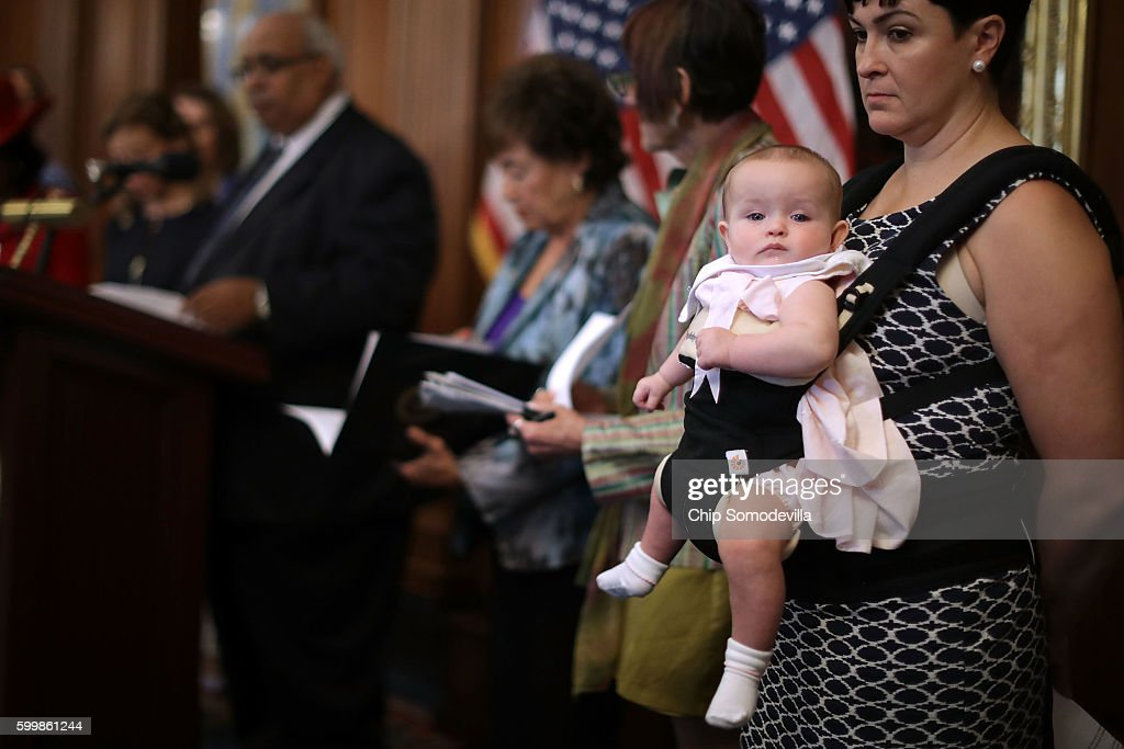 Emily Holubowich and her 6-month-old daughter Jackie join House Minority Leader Nancy Pelosi (D-CA) and fellow Democratic members of the House during a news conference to call on Republicans to fund programs to combat the spread of the Zika virus at the U.S. Capitol September 7, 2016 in Washington, DC. Congress returned yesterday from a seven-week break during which time the Florida Department of Health confirmed the first local cases of Zika on July 29.