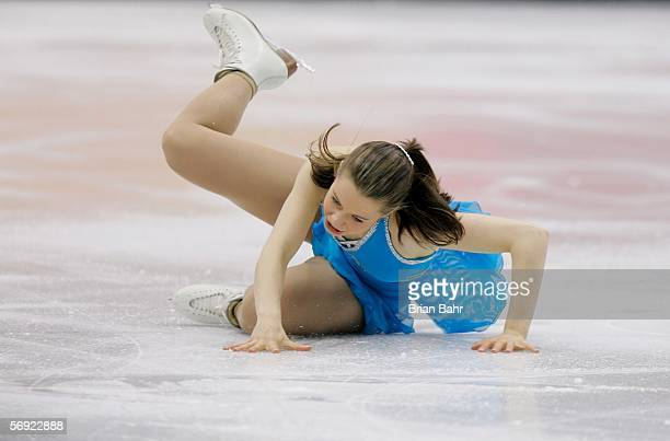 Emily Hughes of the United States falls during her performance in the women's Free Skating program of figure skating during Day 13 of the Turin 2006...