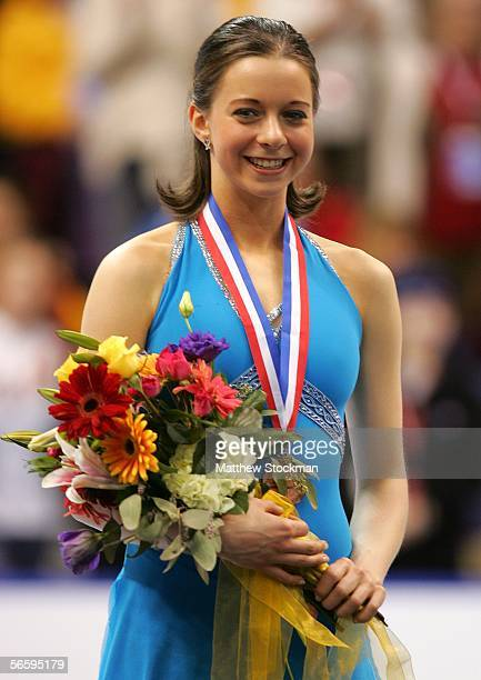 Emily Hughes stands on the podium after receiving the bronze medal at the 2006 State Farm U.S. Figure Championships at the Savvis Center on January...