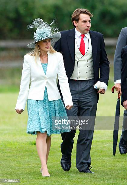 Emily Hutt and James Hutt attend the wedding of James Meade and Lady Laura Marsham at the Parish Church of St Nicholas in Gayton on September 14 2013...