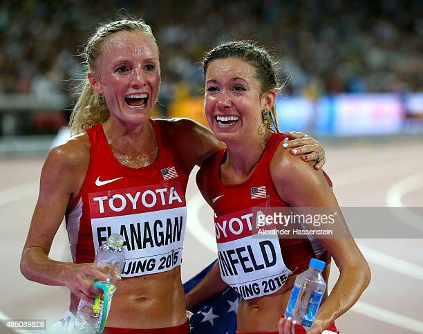 Emily Infeld of the United States is congratulated by Shalane Flanagan of the United States after winning bronze in the Women's 10000 metres final...
