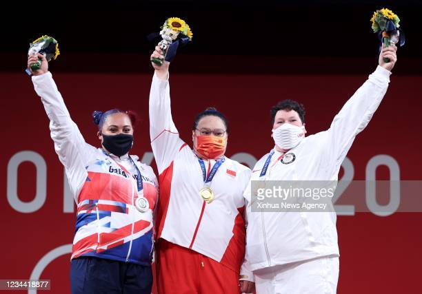 Emily Jade Campbell L of Great Britain, Li Wenwen C of China and Sarah Elizabeth Robles of the United States pose for photos during the awarding...