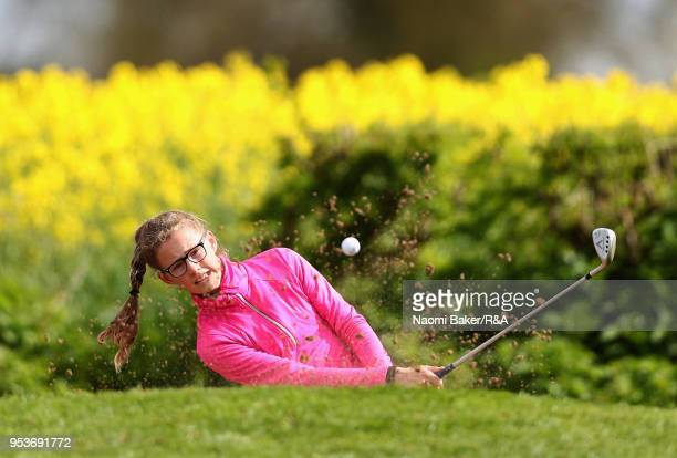 Emily James plays her third shot out of the bunker on the 2nd hole during the final round of the Girls' U16 Open Championship at Fulford Golf Club on...