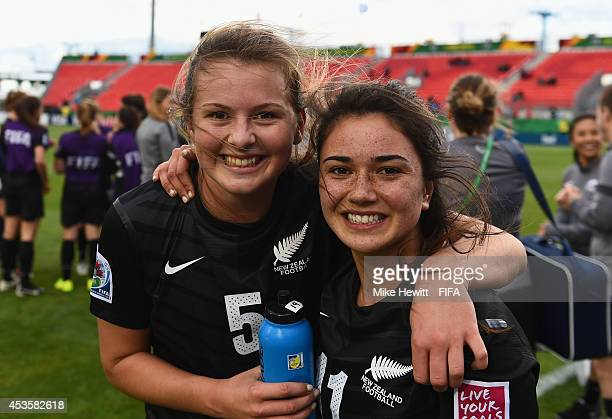 Emily Jensen and Briar Palmer of New Zealand celebrate victory in the FIFA U20 Women's World Cup Canada 2014 Group D match between Costa Rica and New...