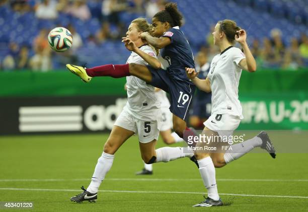Emily Jensen of New Zealand and Mylaine Tarrieu of France battle for the ball during the FIFA U20 Women's World Cup 2014 group D match between New...