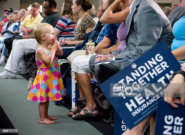 Emily Johnson age 2 enjoys a little light lunch during the 3 hour long town hall meeting on health care hosted by Rick Boucher DVA at the Southwest...