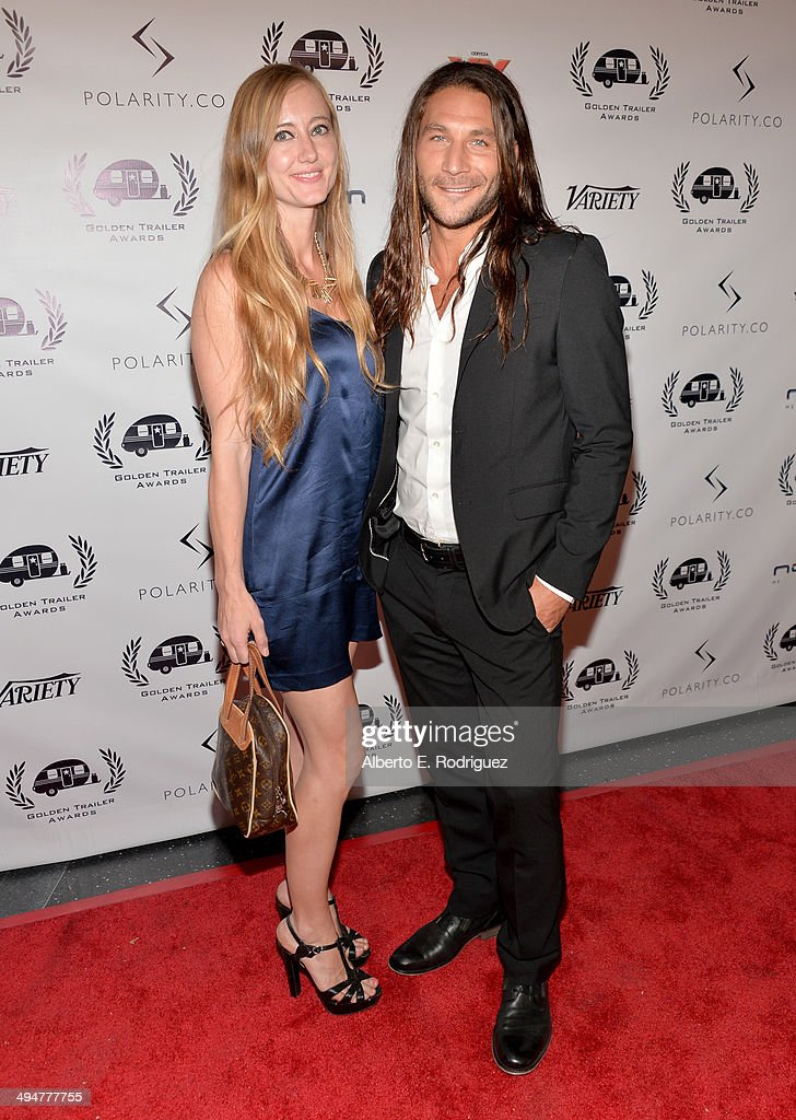 Emily Johnson (L) and actor Zach McGowan attend the 15th Annual Golden Trailer Awards at Saban Theatre on May 30, 2014 in Beverly Hills, California.