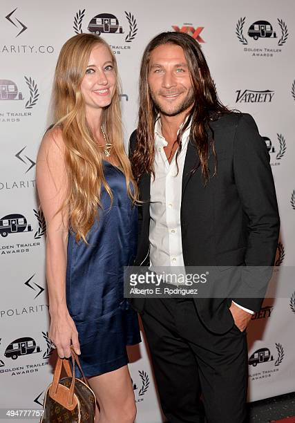 Emily Johnson and actor Zach McGowan attend the 15th Annual Golden Trailer Awards at Saban Theatre on May 30 2014 in Beverly Hills California