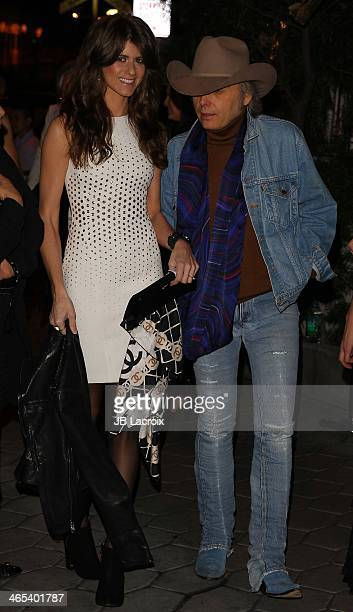 Emily Joyce and Dwight Yoakam attend the Warner Music Group Hosts Annual Grammy Celebration held at Sunset Tower on January 26 2014 in West Hollywood...