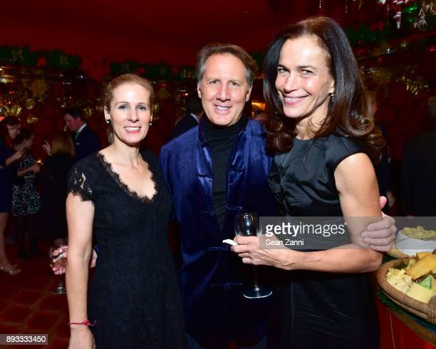 Emily Kaplan Joe Rose and Elizabeth Beyer attend A Christmas Cheer Holiday Party 2017 Hosted by George Farias and Anne and Jay McInerney at The...