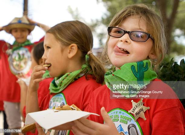 Emily Karpe celebrates National S'mores Day with a liplicking gooey warm creation during Girl Scouts camp in Silverado Canyon on Monday With her is...