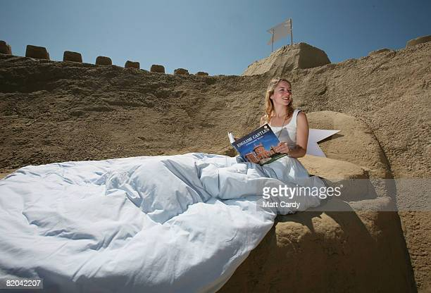 Emily Keogh poses for a photograph inside the world's first sand hotel on Weymouth beach on July 23 2008 in Weymouth England The sand structure which...