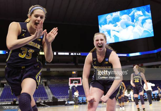 Emily Kiser of the Michigan Wolverines and Danielle Rauch of the Michigan Wolverines celebrate after defeating the Tennessee Lady Vols 70-55 in the...