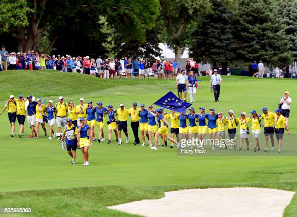 Emily Kristine Pedersen of Team Europe and her caddie are followed up the 16th green by Team Europe during the final day singles matches of the...
