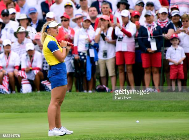 Emily Kristine Pedersen of Team Europe reacts to her missed putt on the 15th green losing five and three during the morning foursomes matches of the...