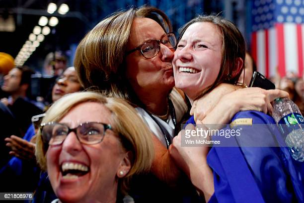 Emily Lindahl hugs and kisses her daughter Maureen Liccione as voting results for Virginia come in at Democratic presidential nominee former...