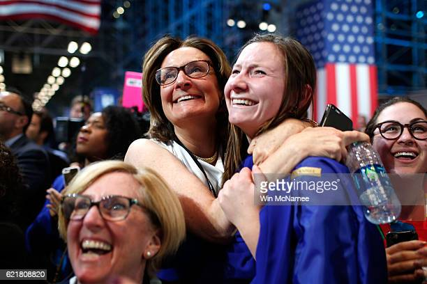 Emily Lindahl hugs her daughter Maureen Liccione as voting results for Virginia come in at Democratic presidential nominee former Secretary of State...