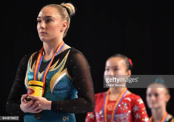 Emily Little of Australia is presented with a jar of Vegemite after finishing second on the Vault during the World Cup Gymnastics at Hisense Arena on...