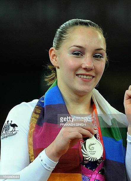 Emily Little of Australia poses during the medal ceremony after winning silver in the Artistic Gymnastics Women's Individual All Round final at...