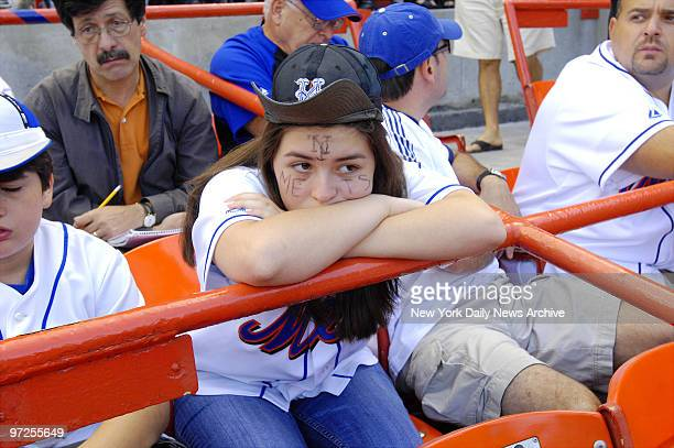 Emily Losordo of Hoboken NJ is visibly dejected along with other New York Mets fans during a game between the Mets and the Florida Marlins at Shea...