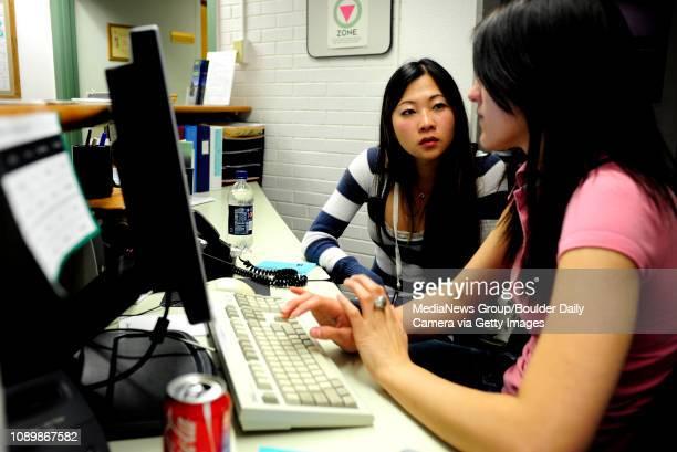 Emily Ma who graduated from CU last May gets help from Irma Spahic from Career Services junior Integrative Physiology major on finding translator...