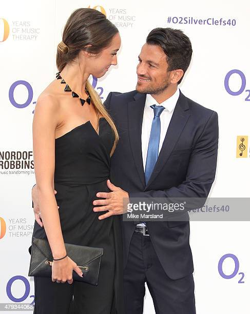 Emily MacDonagh and Peter Andre attend at the Nordoff Robbins O2 Silver Clef Awards at The Grosvenor House Hotel on July 3 2015 in London England