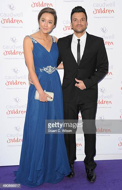 Emily MacDonagh and Peter Andre attend the Caudwell Children Butterfly Ball at The Grosvenor House Hotel on May 15 2014 in London England