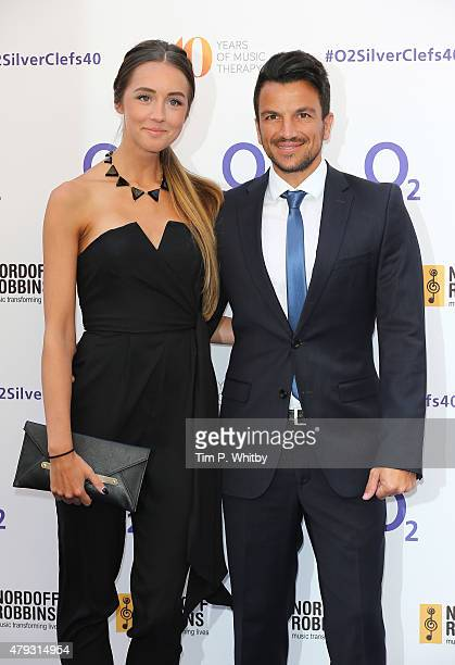 Emily MacDonagh and Peter Andre attend the Nordoff Robbins 02 Silver clef Awards at The Grosvenor House Hotel on July 3 2015 in London England
