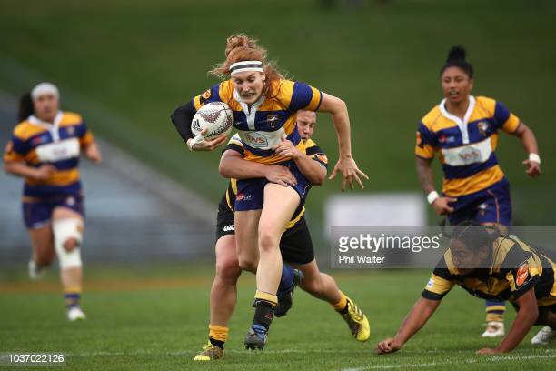 Emily Magee of Bay of Plenty is tackled during the round four Farah Palmer Cup match between Bay of Plenty and Taranaki at Rotorua International...