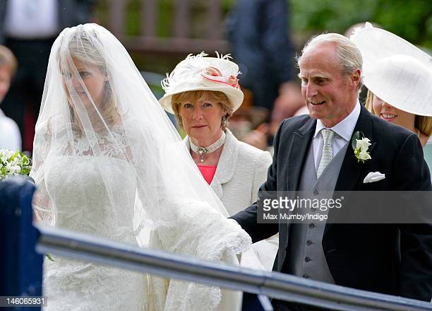 Emily McCorquodale Lady Sarah McCorquodale and Neil McCorquodale arrive for Emily's wedding at The Church of St Andrew and St Mary Stoke Rochford on...