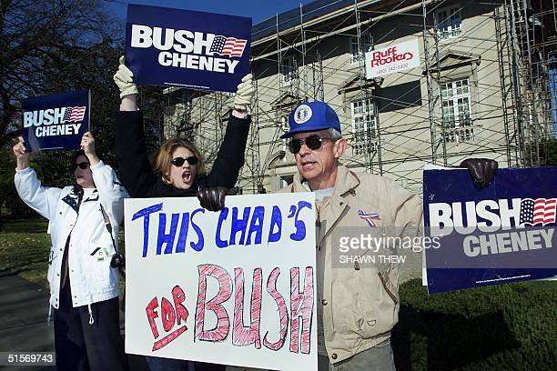 Emily McKinney and Craig Duehring shout support for US Republican presidential candidate George W Bush and his running mate Dick Cheney 18 November...
