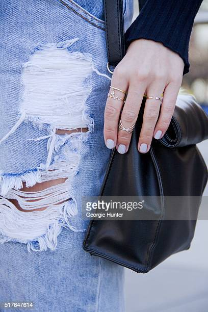 Emily Mercer wearing high waisted ripped One Teaspoon denim skirt Rag Bone navy sweater PaPer minT black leather bag rings by EF Collection Tara 4779...