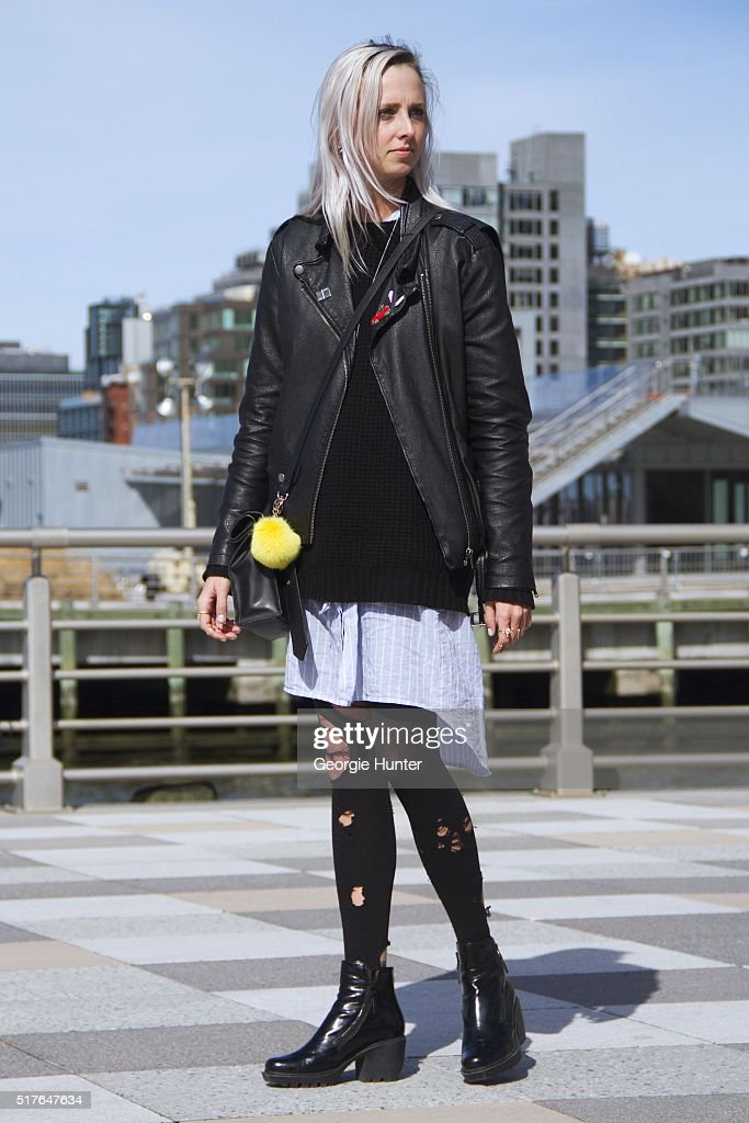 Emily Mercer wearing shirt dress by OAK, Urban Outfitters black leather jacket, black knitted sweater by Levi's, black ripped tights, PaPer minT black leather bag with yellow pompom, black patent booties by Opening Ceremony, rings by Epiphanie, Alison Lou, Elizabeth + James, Nayla Arida, Finn, Zoe Chicco, Michelle Fantaci, Nayla Arida, EF Collection and Tarra 479 all at Stone and Strand on March 26, 2016 in New York City.