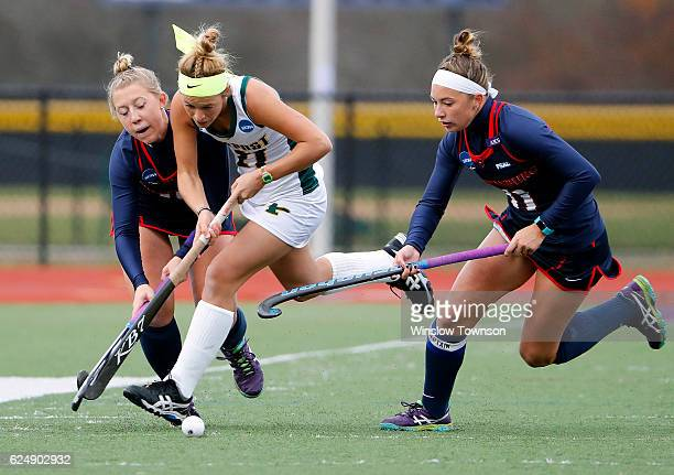 Emily Miller of LIU Post tries to get between two Shippenburg University players during the NCAA Division II Field Hockey Championship at WB Mason...