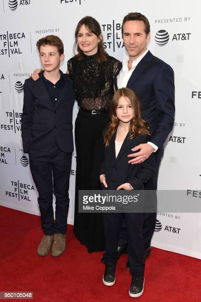 Emily Mortimer and Alessandro Nivola pose with children at a screening of To Dust during the 2018 Tribeca Film Festival at SVA Theatre on April 22...