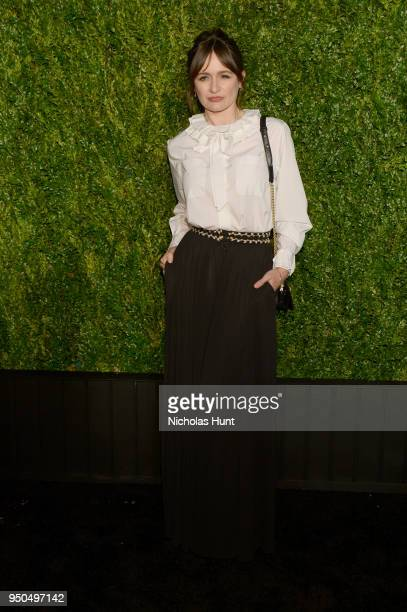 Emily Mortimer wears a CHANEL blouse with black jersey pants, Look 21 from the Cruise 2017/18 Collection and CHANEL Shoes and Bag at the CHANEL...