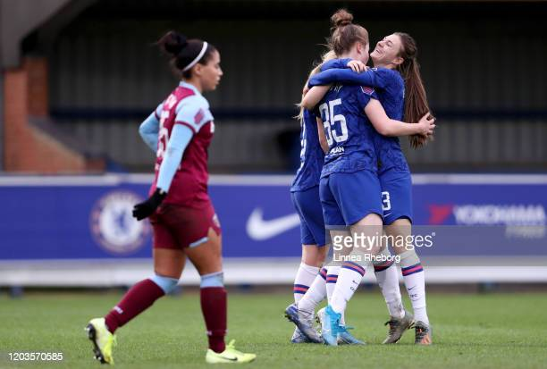 Emily Murphy of Chelsea celebrates with teammates Erin Cuthbert and Hannah Blundell after scoring her sides eighth goal during the Barclays FA...