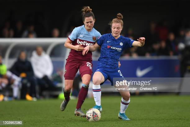 Emily Murphy of Chelsea is challenged by Laura Vetterlein of West Ham United during the Barclays FA Women's Super League match between Chelsea and...